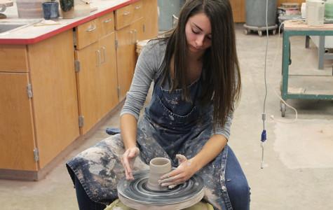 Julianne Russo works diligently in pottery class.