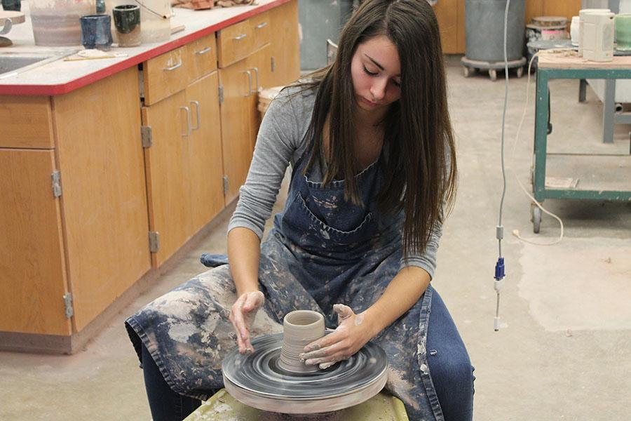 Julianne+Russo+works+diligently+in+pottery+class.