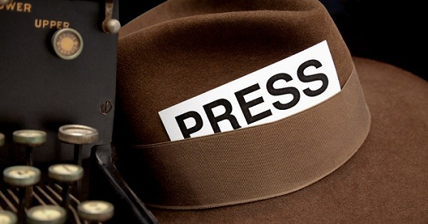 Newspaper Reporter's Press Pass in Hat, White Background.